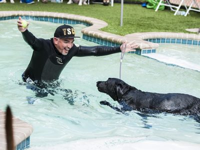 Cesar Milan showing how to train your dog in the pool